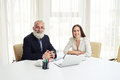 Portrait of smiling young businesswoman and senior in meeting Royalty Free Stock Photo