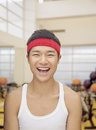 Portrait smiling young man at the gym with red headband Stock Images