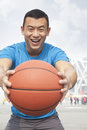 Portrait of smiling young man holding a basketball beijing Stock Photos