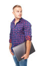 Portrait of smiling young man holding laptop happy isolated on white background Royalty Free Stock Photography