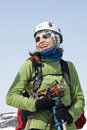 Portrait of smiling young woman equipped ski mountaineer