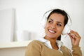 Portrait smiling young woman headphone listening music looking to her right up copyspace Royalty Free Stock Photos