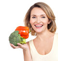 Portrait of a smiling young woman with vegetables isolated on white Royalty Free Stock Photography