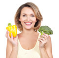 Portrait of a smiling young woman with vegetables isolated on white Royalty Free Stock Images