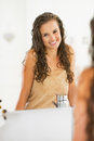 Portrait of smiling young woman with wet hair in bathroom modern Stock Images