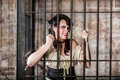 Portrait of sneering female prisoner a in the oldwest Royalty Free Stock Images
