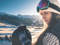Portrait of snowboarder girl on the background of high mountain Royalty Free Stock Photo