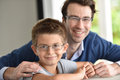 Portrait of son and father wearing eyeglasses Royalty Free Stock Photo