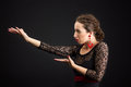 Portrait of spanish woman dancing flamenco on black dancer in dress with red earrings Royalty Free Stock Photos