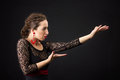 Portrait of spanish woman dancing flamenco on black dancer in dress with red earrings Royalty Free Stock Photo
