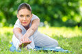 Portrait of sportive woman stretching in park herself concept healthy lifestyle and fitness Royalty Free Stock Photography