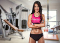 Portrait of sporty woman in gym smiling Stock Photo