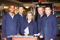 Portrait of staff standing in engineering factory looking to camera Royalty Free Stock Photography