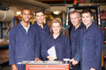 Portrait of staff standing in engineering factory looking to camera smiling Royalty Free Stock Images