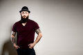 Portrait of standing handsome bearded man in hat Royalty Free Stock Photo