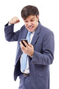 Portrait of a stressed businessman getting bad news by phone Royalty Free Stock Image