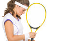Portrait of stressed female tennis player isolated on white Stock Photography