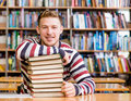 Portrait of a student looking at camera in college library Royalty Free Stock Photo
