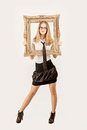 Portrait of a stunning blonde beauty pretty girl with frame in hands Stock Photography