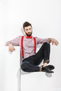 Portrait of stylish man in red suspenders and bow-tie Royalty Free Stock Photo