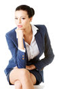 Portrait of successful attractive businesswoman sitting Stock Image