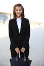 Portrait of a successful business woman smiling beautiful young female executive in an urban setting Stock Photography