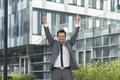 Portrait of successful businessman pointing upwards outside office Royalty Free Stock Photo