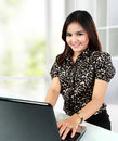 Portrait of successful businesswoman working with laptop isolated over white background Stock Photo