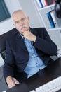 Portrait successful senior businessman in modern office Royalty Free Stock Photo