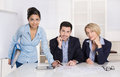 Portrait: successful smiling business team of three people; man Royalty Free Stock Photo
