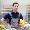 Portrait of successful workman in an industrial company, in work Royalty Free Stock Photo