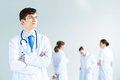 Portrait of successful young doctor a and hospital staff Royalty Free Stock Images