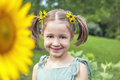 Portrait of sunflower girl young wearing sunflowers in her hair in a patch Royalty Free Stock Photos