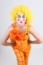 Portrait of surprised clown with bow Stock Images