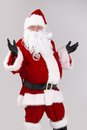 Portrait of surprised santa claus looking at camera isolated on gray background Stock Photo