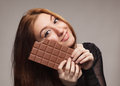 Portrait of sweet girl with the big chocolate young Stock Photos