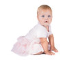 Portrait of a sweet infant wearing a pink tutu, necklace, and headband bow, , isolated on white background Royalty Free Stock Photo