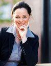 Portrait of a sweet mature business woman smiling Stock Photos