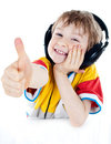 Portrait of a sweet young boy listening to music Royalty Free Stock Photo