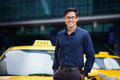 Portrait taxi driver smile car driving happy of chinese leaning on yellow with arms crossed smiling and looking at camera Stock Image