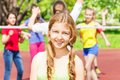 Portrait of teen girl with friends play volleyball Royalty Free Stock Photo