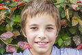 Portrait of teenage boy at bush Royalty Free Stock Photo