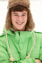 Portrait Of Teenage Boy In Snow Wearing Fur Hat Royalty Free Stock Photography