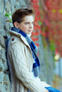 Portrait of teenage boy at wall outdoors brick Royalty Free Stock Images