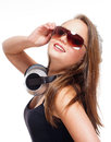 Portrait of a teenage girl with headphones sunglasses and Stock Photography