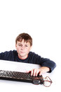 Portrait of a teenager with a keyboard on white background Royalty Free Stock Image