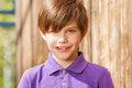 Portrait of ten years old boy in purple polo shirt Royalty Free Stock Photo