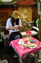 Portrait thai woman with breakfast in morning at resort thailand foods vary widely from place to place but often include a Royalty Free Stock Images