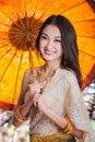 Portrait of thai young lady in sakura garden in thailand dance wea with umbrella Royalty Free Stock Photo