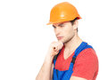 Portrait of thinking handyman in uniform closeup isolated on white background Stock Photos